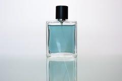 Perfume. Transparent bottle of perfume on a white background Royalty Free Stock Photo
