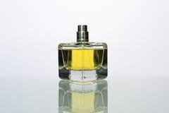 Perfume. Transparent bottle of perfume on a white background Stock Photo
