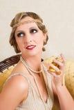 Perfume twenties vintage style. Vintage woman in twenties flapper dress style spraying perfume Stock Image