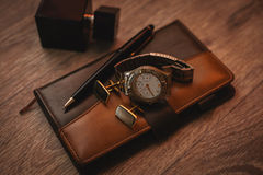 Perfume with watch and notepad. Male accessories. Perfume with watch and notepad Stock Image