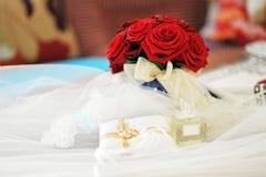 Perfume  and wedding rings Royalty Free Stock Image