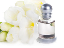 Perfume and white flowers Stock Photography