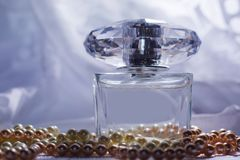 Perfume with white pearls Royalty Free Stock Photo