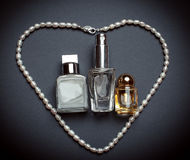 perfume and white pearls. Women's accessories Royalty Free Stock Photography