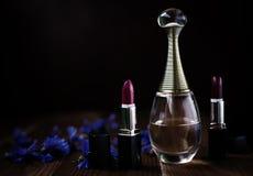 Perfume wiyh lipstick Royalty Free Stock Photography