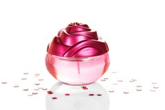 Perfume for women decorated with asterisks Royalty Free Stock Image