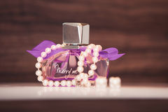 Perfume for women and jewelry Stock Image