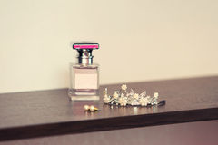 Perfume for women of pink color and diadem Royalty Free Stock Photography