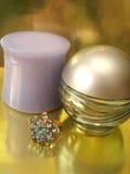 Perfume y crema Foto de archivo