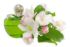 Perfume y flores Fotos de archivo libres de regalías