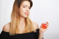 Perfume. Young pretty woman smelling aroma with pleasure, image.  Royalty Free Stock Images