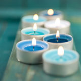 Perfumed candles. And wooden ground stock image