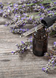 Perfumed herbal oil essence and dreied lavender flowers Royalty Free Stock Image