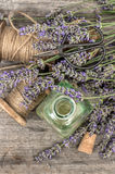 Perfumed herbal oil essence and lavender flowers. Vintage decora Royalty Free Stock Image