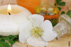 Perfumed oil, rose and candle Stock Photo