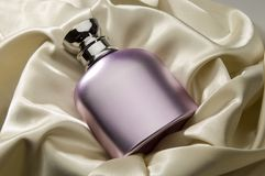 Perfumery. The bottle of spirits laying on a fabric Stock Photo
