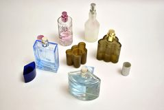 Perfumery. Man's and female in open bottles Stock Images