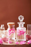 Perfumery and aromatherapy set with rose flowers and flasks Stock Photo