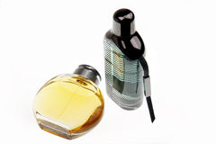 Perfumes. Man's perfume and women perfume are on the white background Royalty Free Stock Photos