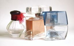 Perfumes. Three perfumes with bright background Royalty Free Stock Image