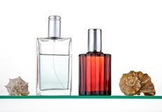 Perfumes. Perfume with decoration on a glass shelf Royalty Free Stock Image