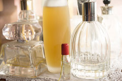 Perfumes and charm and appeal. Charm appeal and beauty with perfumes bottle Royalty Free Stock Photo
