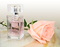 Perfumes and flower roses Royalty Free Stock Image