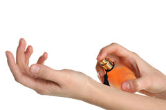 Perfumes in the hands Stock Photo