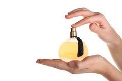 Perfumes nas mãos Fotografia de Stock Royalty Free