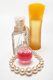Perfumes and necklace Royalty Free Stock Photo