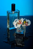 Perfumes and orchid Stock Photo