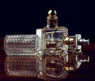 Perfumes over dark Stock Photography