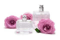 Perfumes with roses on white background Stock Images