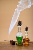 Perfumes and smoke Stock Image