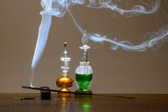 Perfumes and smoke Royalty Free Stock Photography