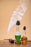 Perfumes and smoke Royalty Free Stock Image