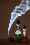 Perfumes and smoke Royalty Free Stock Photo