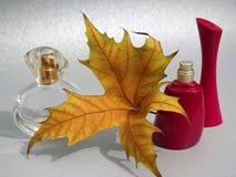 Perfumes and yellow lamina Royalty Free Stock Images