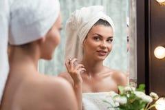 Perfuming after bath Stock Photos