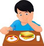 Perfuração do rapaz pequeno a comer ilustração stock