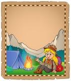 Pergamino con la muchacha del explorador en montaña Imágenes de archivo libres de regalías