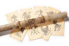 Pergamino viejo con la tarjeta del zodiaco Imagen de archivo libre de regalías