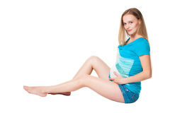 Pergnant woman in blue clothes sitting Stock Photo