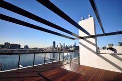 Pergola. Over wooden patio decking, city skyline Stock Photography