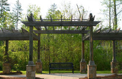 Pergola. Large pergola with a tranquil bench in the center Stock Images