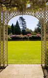 Pergola. View of a beautiful garden from under a pergola Stock Images