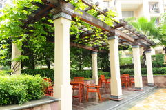 The pergola in a garden. A cement pergola in an apartment block patio garden Royalty Free Stock Photos