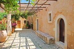 Photo made in Greece. Pergola of grapes in the patio Greece Cret. Pergola of grapes in the patio Greece Crete Stock Photo