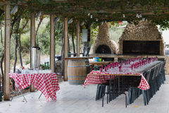 Pergola with a laid table Stock Images