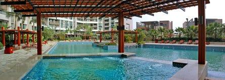 Pergola and swimming pool Stock Images